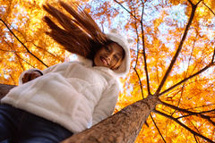 Happy young beautiful woman in autumn park on sunny day, Young woman in white coat during sunset in the park Stock Photo