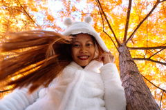 Happy young beautiful woman in autumn park on sunny day, Young woman in white coat during sunset in the park Stock Photography