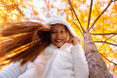 Happy young beautiful woman in autumn park on sunny day, Young woman in white coat during sunset in the park Royalty Free Stock Images