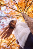 Happy young beautiful woman in autumn park on sunny day, Young woman in white coat during sunset in the park Stock Images