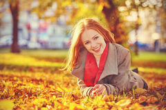 Happy young beautiful woman in the autumn Stock Photos