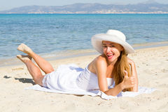 Happy young beautiful woman  on the beach Stock Image