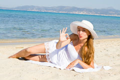 Happy young beautiful woman  on the beach Royalty Free Stock Images