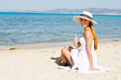 Happy young beautiful woman  on the beach Royalty Free Stock Photos