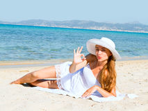 Happy young beautiful woman  on the beach Royalty Free Stock Image