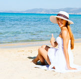 Happy young beautiful woman  on the beach Stock Photo