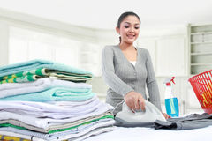 Woman ironing clothes Stock Images