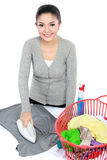Woman ironing clothes Stock Photography