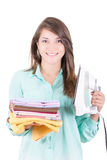 Happy young beautiful woman ironing clothes. Stock Photography