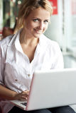 Happy young beautiful woman with laptop - indoors Stock Photos