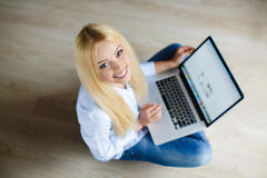 Happy young beautiful woman with laptop indoors Royalty Free Stock Photography