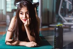 Happy young beautiful woman lifestyle sport portrait training wo. Rkout exercise cardio at fitness gym royalty free stock photos