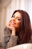 Happy young beautiful woman relaxing on so Royalty Free Stock Image