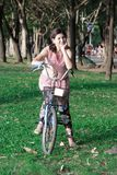 Happy young beautiful woman with retro bicycle stock photo
