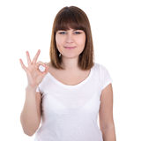 Happy young beautiful woman showing ok sign isolated on white Stock Photography