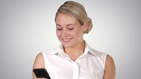 Happy young beautiful woman smiling and using mobile phone, Alpha Channel stock video