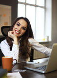 Happy Young Beautiful Woman Using Laptop, Indoors Stock Photo