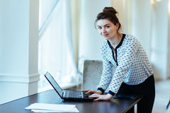 Happy Young Beautiful Woman Using Laptop, Indoors.  Royalty Free Stock Images