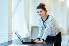 Happy Young Beautiful Woman Using Laptop, Indoors.  Royalty Free Stock Image