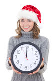 Happy young beautiful woman in winter clothes and santa hat hold Royalty Free Stock Images