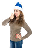Happy young beautiful woman in winter clothes and santa hat thum Stock Photo