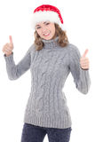 Happy young beautiful woman in winter clothes and santa hat thum Stock Photos
