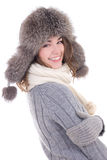 Happy young beautiful woman in woolen sweater and fur hat isolat Royalty Free Stock Images