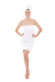 Happy young beautiful woman wrapped in towel isolated on white - Royalty Free Stock Photography