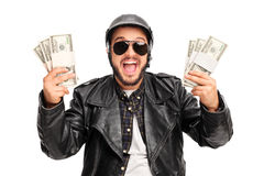 Happy young biker holding money Stock Photos