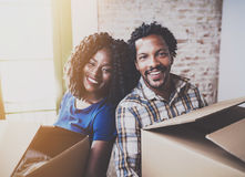 Happy young black african couple moving boxes into new home together and making a successful life.Cheerful family royalty free stock photo