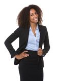 Happy young black business woman. Portrait of a happy young black business woman posing on isolated white background stock image