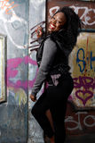 Happy Young Black Female Posing at Vintage Wall Stock Images