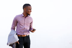 Happy young black guy with a mobile phone Royalty Free Stock Photos