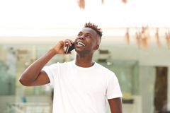 Free Happy Young Black Guy Standing Outdoors And Making A Phone Call Royalty Free Stock Images - 102915299