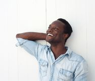 Happy young black man laughing outdoors Stock Photography