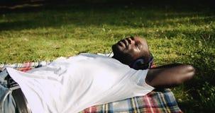 Afro-american Man Enjoying music in Park stock video footage