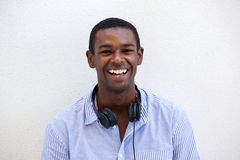 Happy young black man smiling with headphones Royalty Free Stock Photography