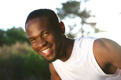 Happy young black man smiling outdoors Royalty Free Stock Image