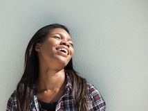 Happy young black woman laughing outdoors Stock Photo