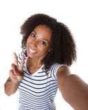 Happy young black woman making selfie Stock Photography