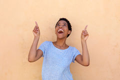Happy young black woman pointing fingers up Royalty Free Stock Photo