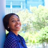 Happy young black woman smiling outdoors Royalty Free Stock Photos