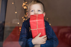 Happy Young Blond Boy with Gift Box. Christmas. Birthday Royalty Free Stock Image