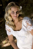 Happy young blond bride Stock Images