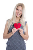 Happy young blond caucasian woman holding red heart - isolated o Royalty Free Stock Images