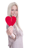 Happy young blond caucasian woman Holding red heart. Stock Photos