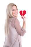 Happy young blond caucasian woman Holding red heart. Royalty Free Stock Photo