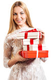 Happy young blond girl with presents Stock Images