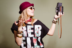 Happy young blond hipster in funny outfit making Royalty Free Stock Images