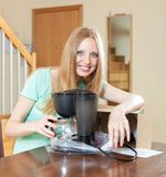 Happy young blond with new  coffee maker in home interior Royalty Free Stock Photography